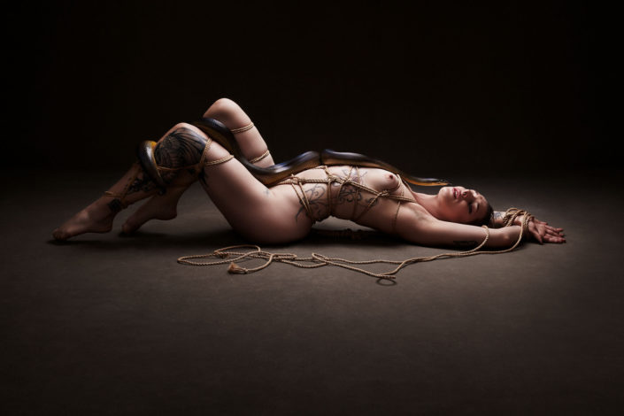 Girl bound in rope with a snake advertising photographer Melbourne